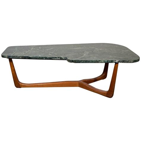 vladimir kagan style asymmetric coffee table with green