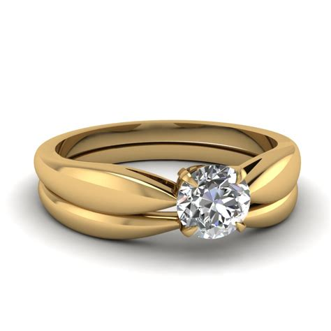 Silver Tapered Bow Ring tapered bow solitaire wedding ring set in 14k yellow gold