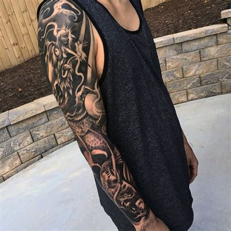 dragon sleeve tattoo black and grey images 70 dragon arm tattoo designs for men fire breathing ink