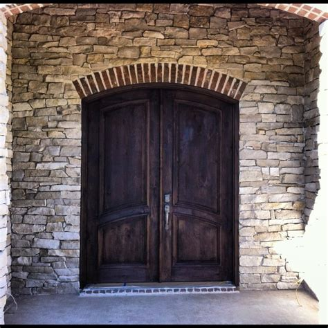 dark brown front door natural stone and jacobean dark brown stain on entryway