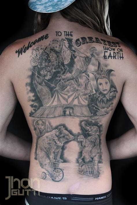 circus back piece progress shot by jhon gutti tattoos