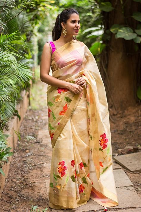 Expand Floral Print Blouse Oranye beige and gold checked organza saree with pink orange and