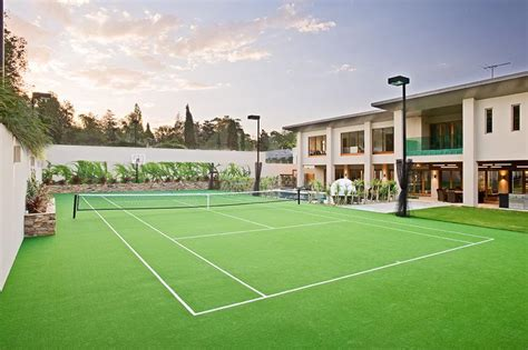 cost to build tennis court in backyard grass court smita walhekar sports academy