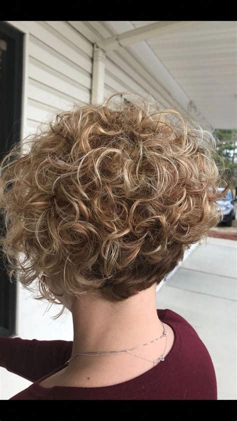 short curly angled bob  root shadow  blonde