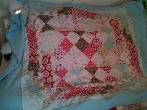plaid en patchwork en tissus tilda marine et ses aiguilles