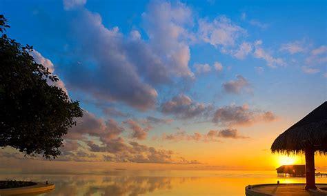 sunset  water bungalows bora bora tahiti polynesia