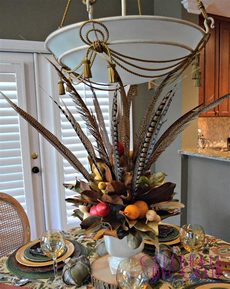 fall centerpieces with feathers a fall centerpiece of magnolia leaves and feathers celebrate decorate