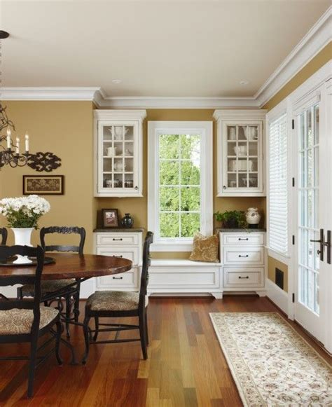 rich gold walls are complimented with white cabinets and warm woods rooms we