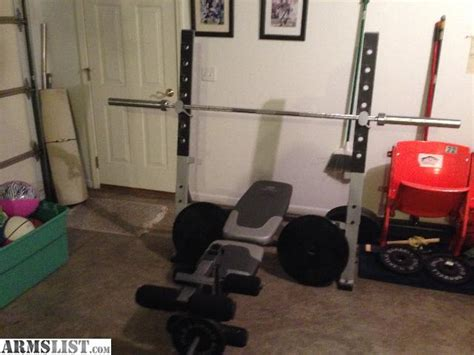 gym bench and weights for sale armslist for sale trade gold s gym weight bench with