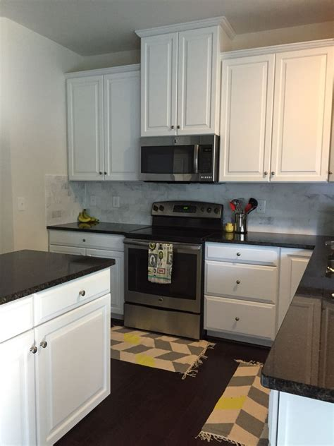 Measuring Countertops For Granite by Black And White Kitchen With Honed Marble Backsplash And