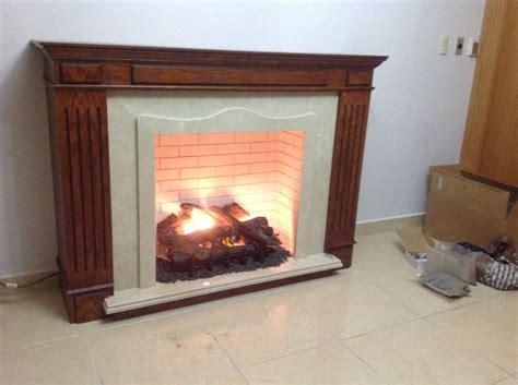 Eclectic Home Decor chimenea de madera marmol y recubrimiento de cemento