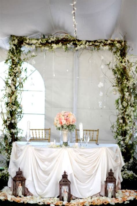 wedding sweetheart table  lanterns  flower petals