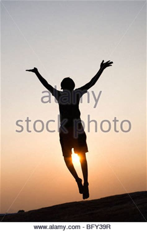 silhouette profile of a young indian boy dancing and