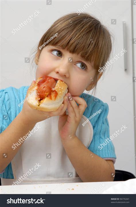 female hot dog eating chion little girl eating hot dog eating stock photo 96776341