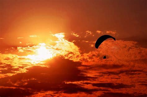 sunset orange free photo sunset orange sun paragliding free image