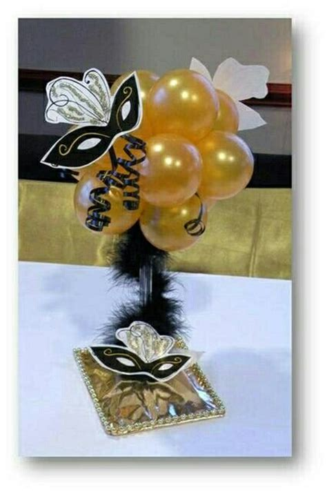 centerpiece for masquerade party sweet 16 pinterest