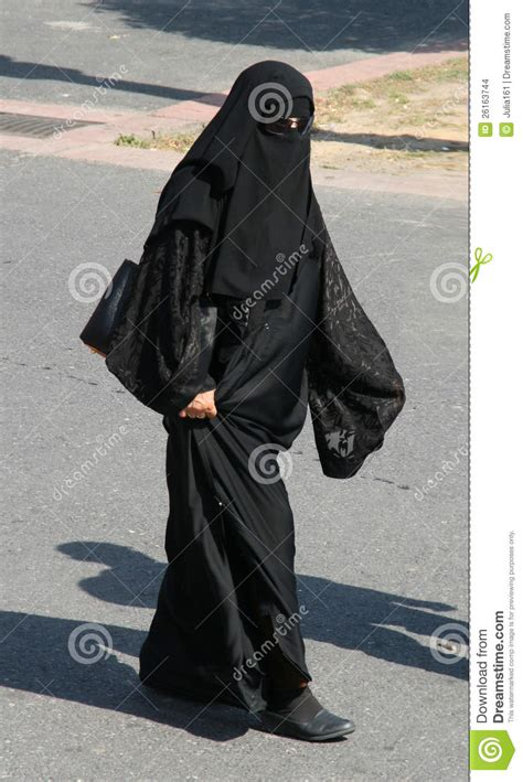 muslim woman  abaya  sun glasses editorial stock