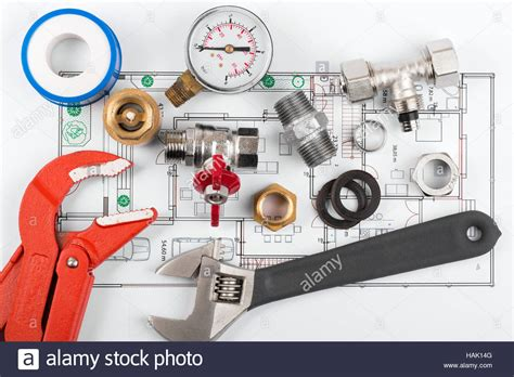 Plumbing Tools And Equipment by Plumbing Tools And Equipment On Blueprint Stock Photo