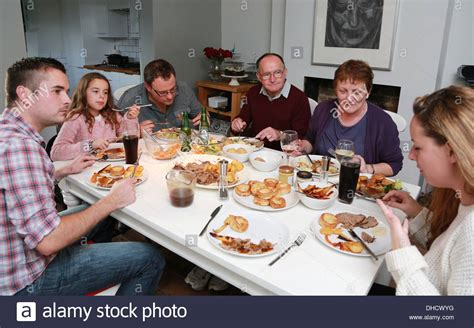 typical british family sunday dinner stock photo royalty free image 62364052 alamy