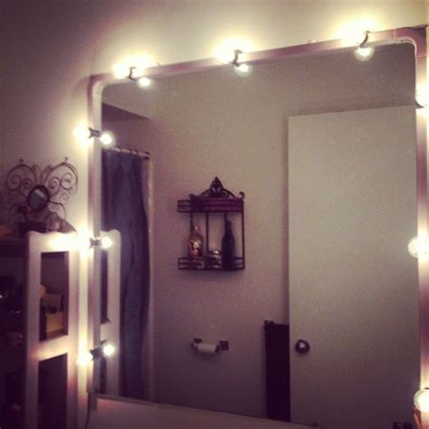 Light A Match Bathroom Diy Vanity Lighting With A String Of Bulbs And Electrical Cord Hiders Painted To Match Bathroom
