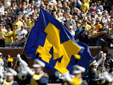 canva umich university of michigan michigan flag flies on game day