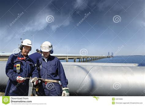 two workers fatally overcome by gas at the norske skog paper mill of albury the border mail workers with pipeline royalty free stock photo image 34975685
