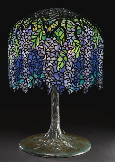 who is louis comfort tiffany tiffany studios a superb quot wisteria quot table l sotheby s