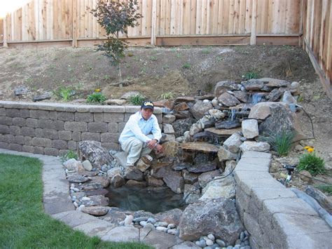 residential landscape waterfall and retaining wall