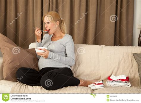 woman eats couch pregnant woman eating a healthy lunch royalty free stock