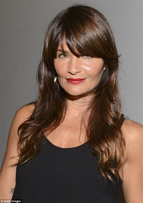 Helena Shirt by Helena Christensen Shows Legs In Denim Skirt