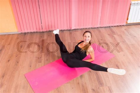 legs open spread high angle view of smiling young female dancer lying on