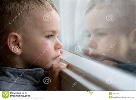 Looking Out Looking In boy looking out window stock image image of look
