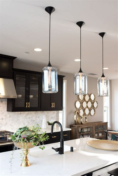 a classic black and gold kitchen deserves classic pendants