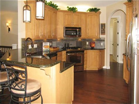 honey oak cabinets with dark hardwood floor birch
