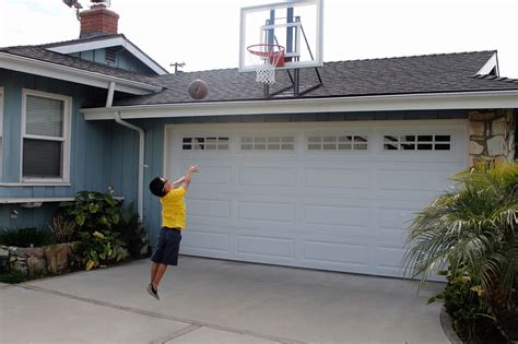 Garage Net The Roof King Gold Basketball Hoop Is Mounted To A Typical