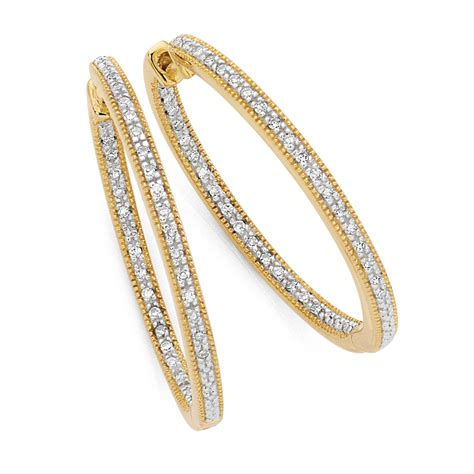Hoop Earrings With hoop earrings with 1 4 carat tw of diamonds in 10kt yellow