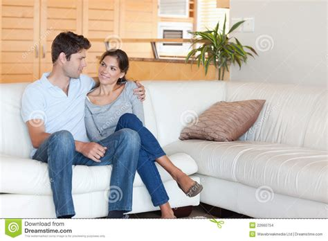 couch sitting smiling couple sitting on a couch stock images image