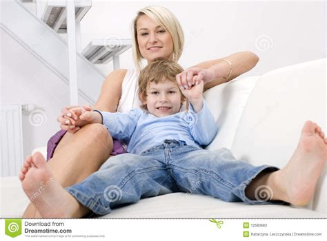 mom on sofa mother and son relaxing stock photos image 12583683