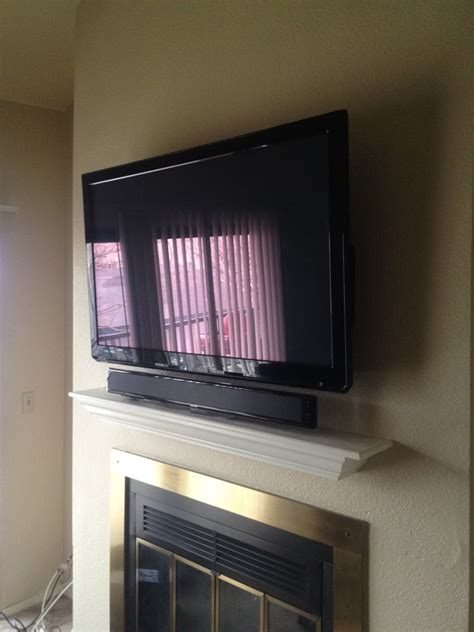mount sound bar on top of tv tv wall mount above a fireplace with sound bar yelp