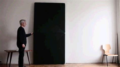 Origami Door - klemens torggler s hingeless flip panel door folds open