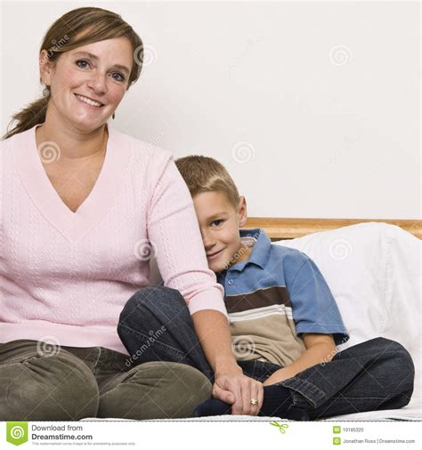 mom son bed mother and son sitting on bed stock photo image 10185320