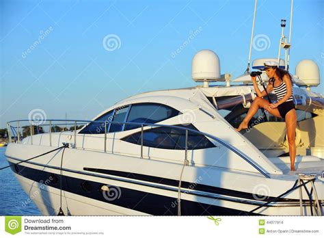 women on boats woman in stylish swimsuit and captain hat on private speed
