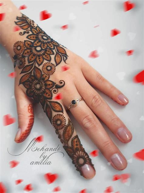 black henna tattoo on hand black henna border with henna inside oh for the