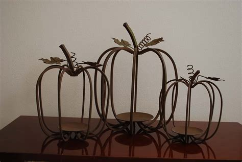 wire pumpkins embellished with ribbon