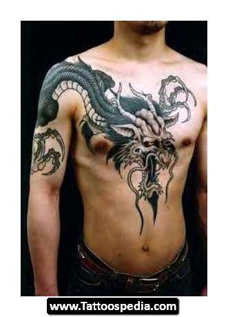tattoo on chest and upper arm dragon upper arm n chest tattoo design tattooshunt com