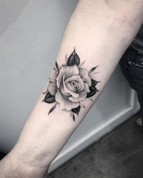 beautiful black amp grey rose tattoo on forearm