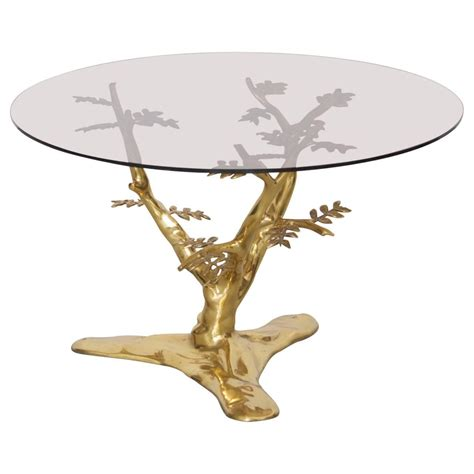 brass tree sculpture coffee table with glass top for