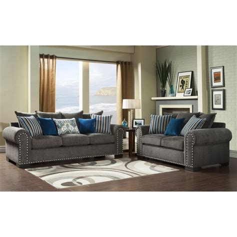 grey sofa with blue pillows give your living room a swanky look with the addition of