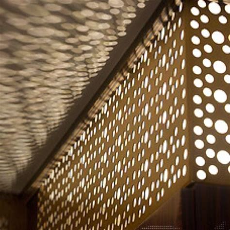 perforated metal wall beyond lighting