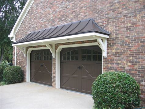metal roof bracket portico over double garage doors designed and built by georgia front porch